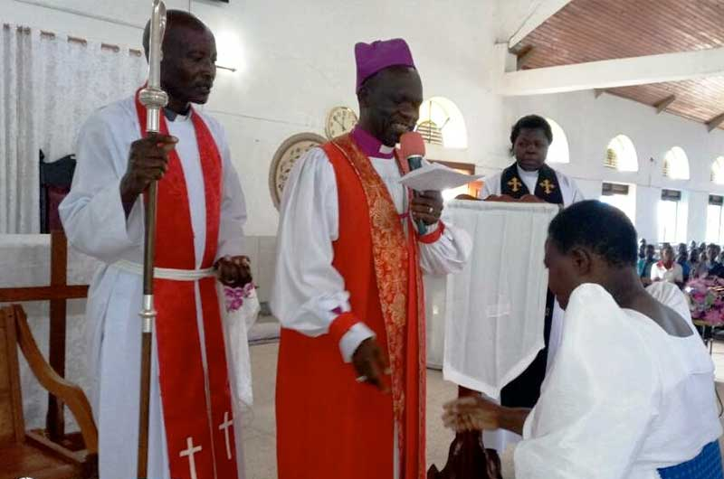 Bishop with Hellen Drateru