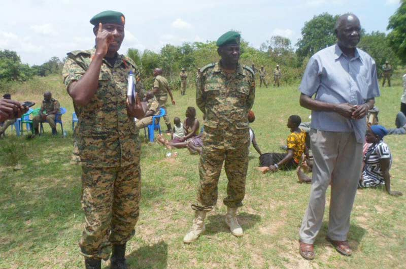 Col Tuhame (L) addressing Congolese and Ugandan nationals
