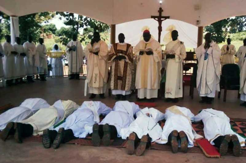 Deacons and the seminarian in an act of Prostration