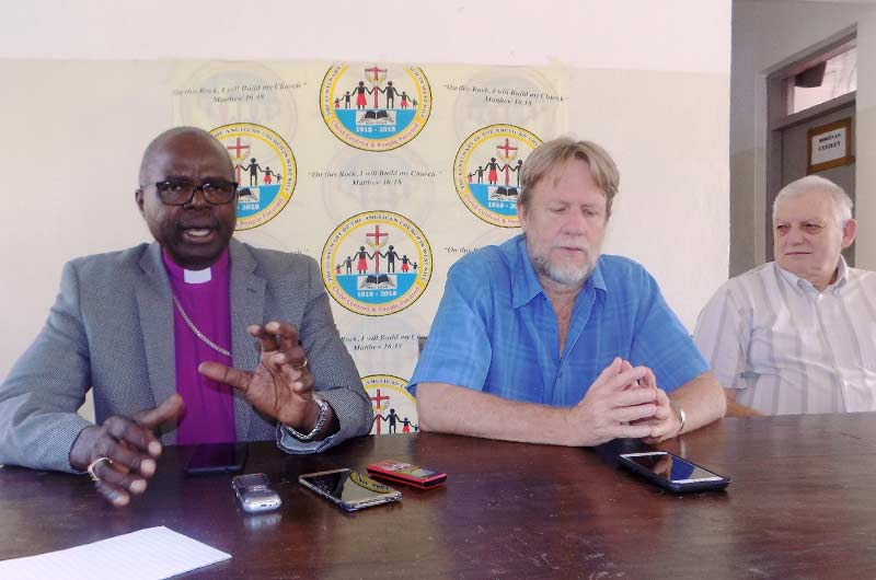 Retired Archbishop Henry Luke Orombi, Dr Luke Herrin and John Casses