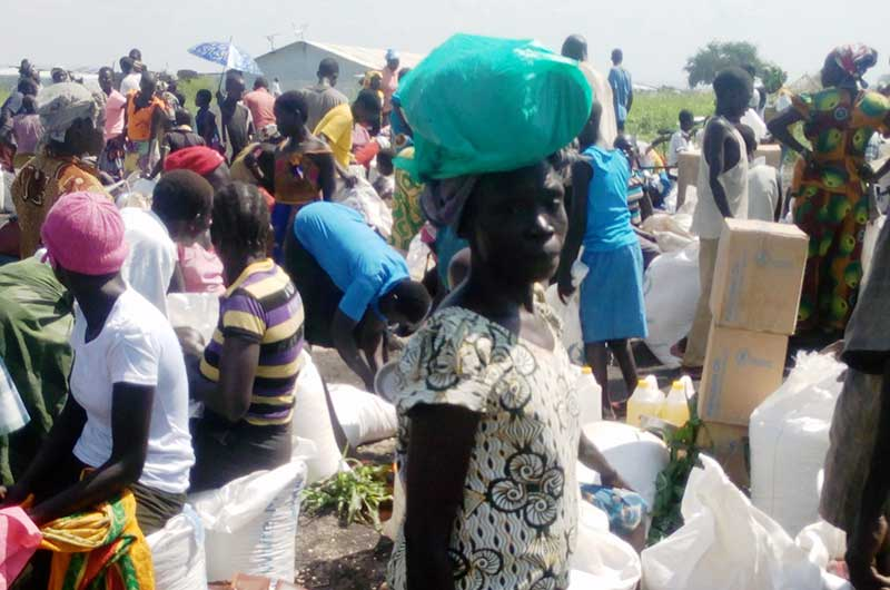 Some of the South Sudan refugees at Morobi recieving their food rations