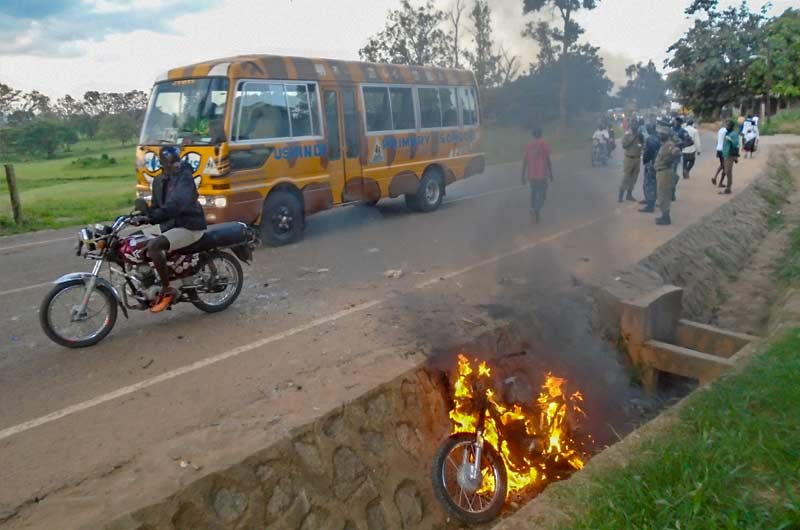 police motorcycle set ablaze
